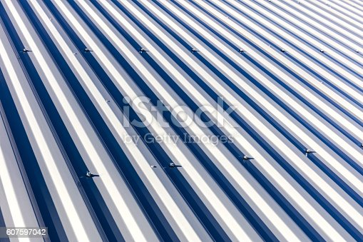 istock corrugated metal roof background texture in sunlight 607597042