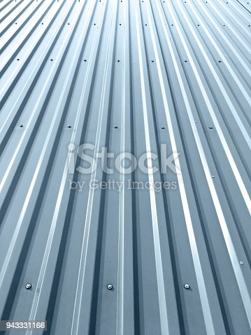 istock corrugated metal roof with rivets on industrial building 943331166