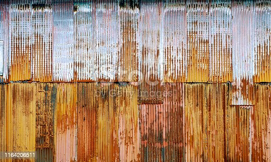 istock Corrugated Metal Wall - from a building in Ketchikan, Alaska - with fading colors for use as a Background 1164206511