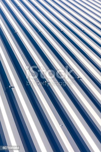 istock corrugated metal with bolts for roofing on industrial buildings 607595984