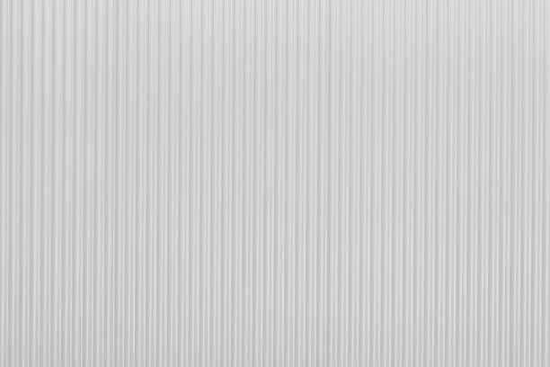 Corrugated new white zinc metal wall of fence as textured and background Corrugated new white zinc metal wall of fence as textured and background sheet metal stock pictures, royalty-free photos & images
