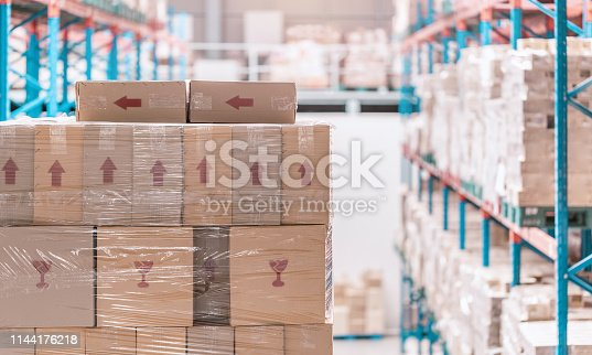 istock corrugated paperboard carton stacked on shelf in warehouse or depot 1144176218