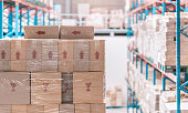 corrugated paperboard carton stacked on shelf in warehouse or depot, transportation industrial concept