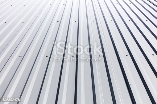 istock corrugated steel cladding with rivets on industrial building 607592478