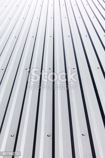 istock corrugated steel roof with rivets on industrial building 607592702
