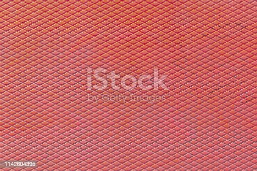 istock Corrugated steel sheet with rust. Rhombic pattern 1142604395