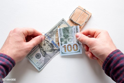 848170878istockphoto corrupt man takes a bribe. money in a mouse trap 921984956
