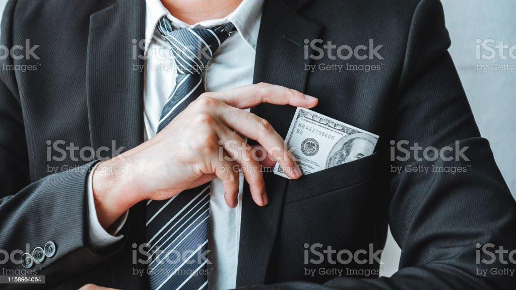 Corruption and Bribery,Businessman giving dollar bills corruption bribery to business manager to deal contract Corruption and Bribery,Businessman giving dollar bills corruption bribery to business manager to deal contract Adult Stock Photo