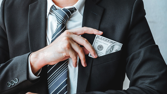 Corruption And Briberybusinessman Giving Dollar Bills Corruption Bribery To Business Manager To Deal Contract Stock Photo - Download Image Now