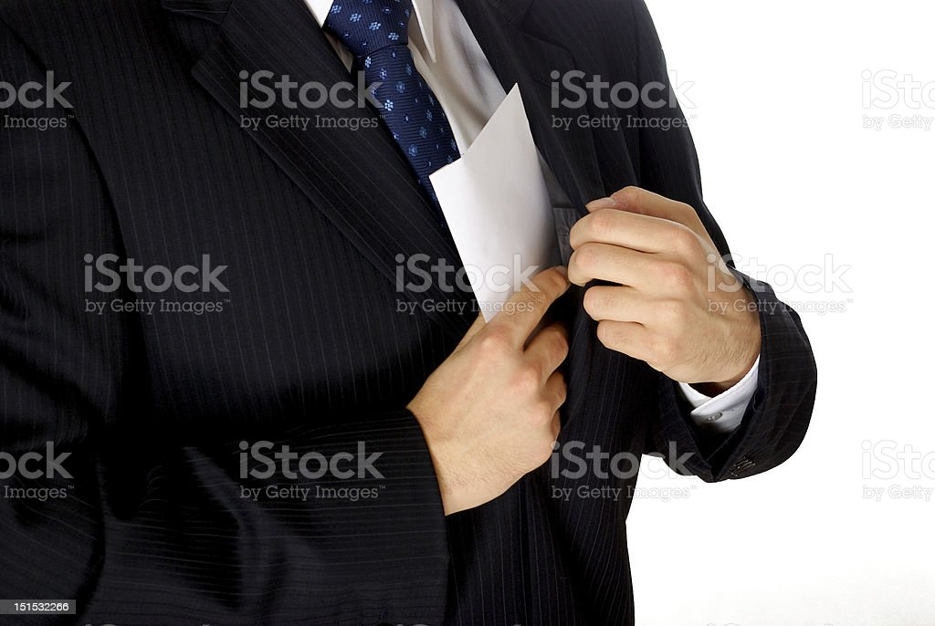 Corruption concept of businessman putting bribery in pocket stock photo