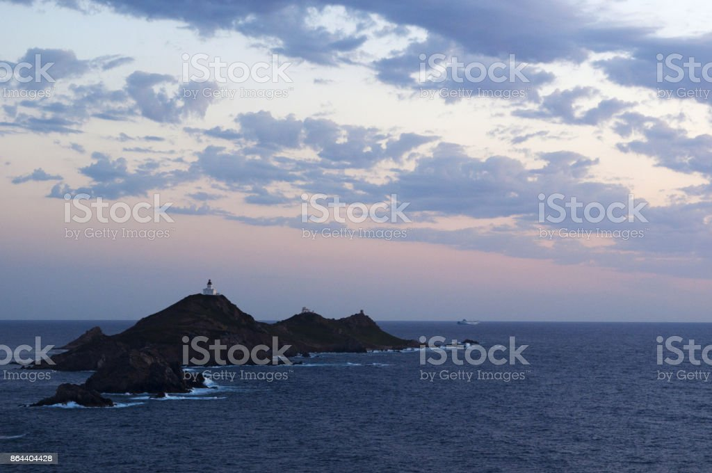 Corsica: a pink sunset on the Iles Sanguinaires (Bloody Islands), famous four dark red porphyry islands with a lighthouse dating 1844 stock photo