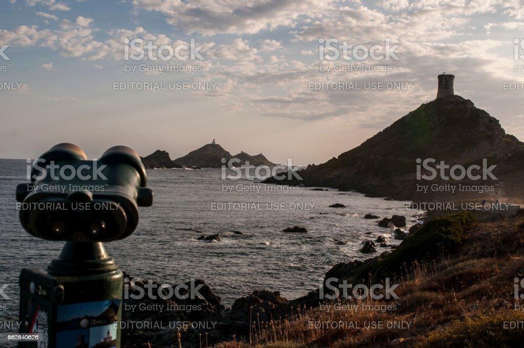 Corsica: binoculars pointed on La Parata Tower, a ruined Genoese tower built in 1608, and on the Iles Sanguinaires (Bloody Islands), the famous four dark red porphyry islands stock photo