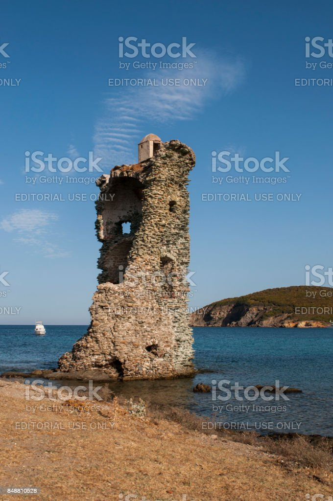 Corsica, Cap Corse: view of the Tower of Santa Maria Chjapella (1549), a ruined Genoese tower at Plage de Santa Maria (Saint Mary beach) stock photo