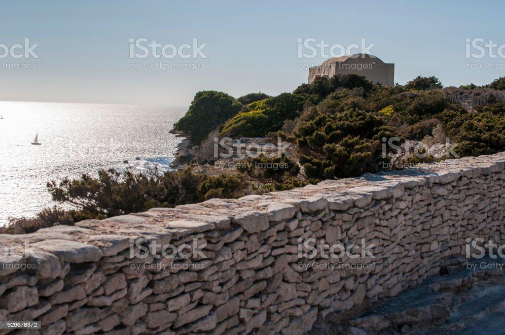 Corsica: stone building on the footpath of the International Bouches de Bonifacio marine park, nature reserve on the top of the limestone of the Strait of Bonifacio stock photo