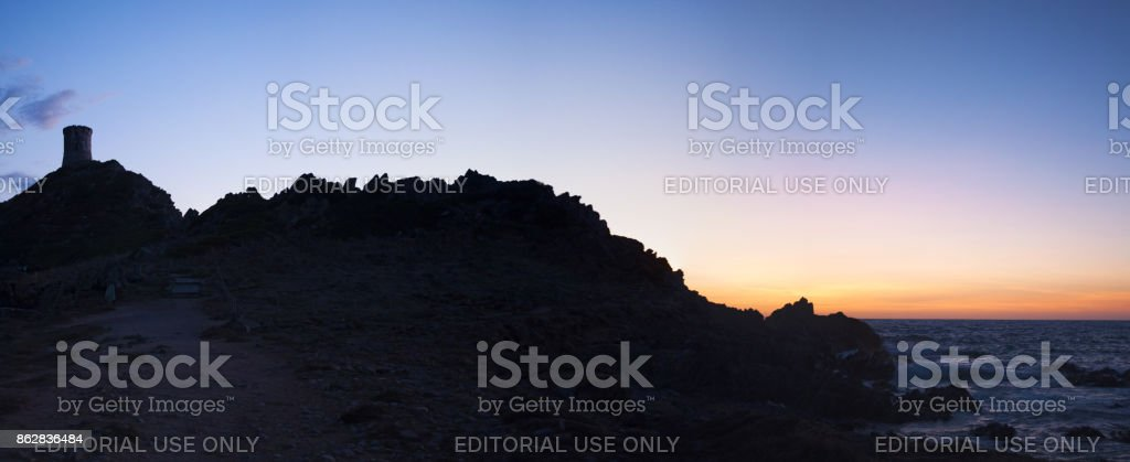 Corsica: sunset on La Parata Tower, a ruined Genoese tower built in 1608 in front of the Iles Sanguinaires (Bloody Islands) stock photo