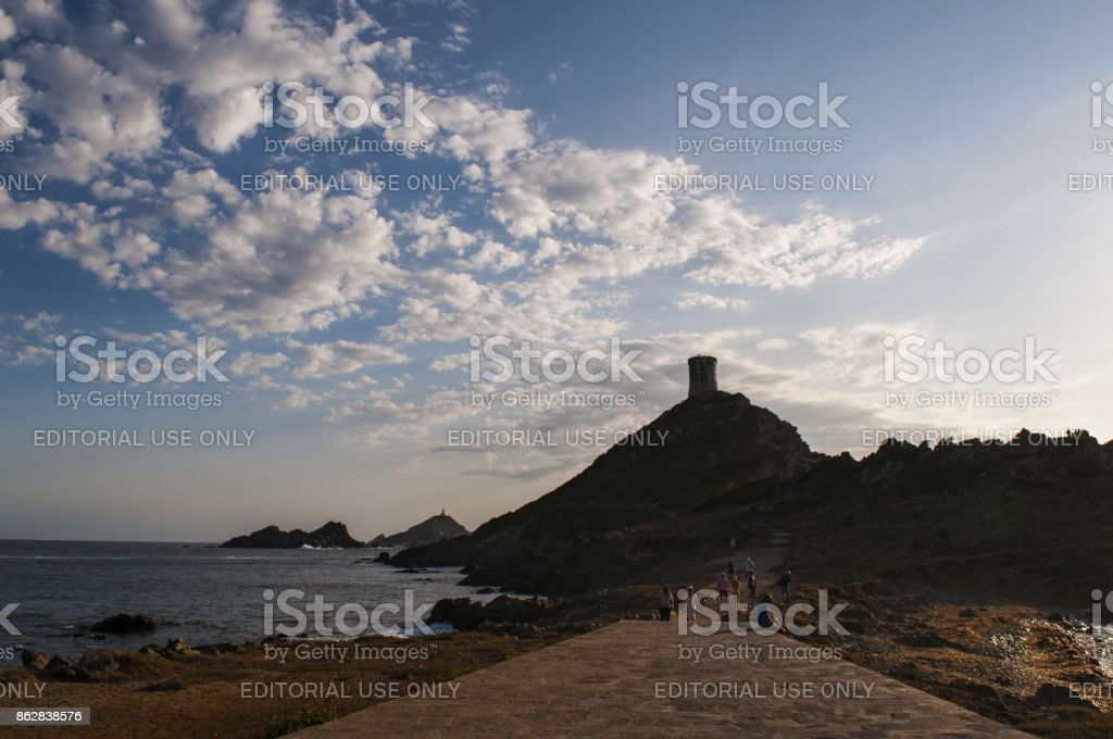 Corsica: sunset on the panoramic footpath to La Parata Tower, ruined Genoese tower built in 1608 with view of the Iles Sanguinaires (Bloody Islands) stock photo