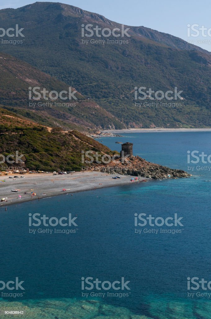 Corsica: the coast of the western side of the Cap Corse, famous for its wild landscape, with view of one of the many black beaches along the coastline stock photo