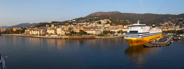 Corsica: the skyline of Bastia, the city at the base of the Cap Corse, seen from the dock of the main port of the island from which ferries and cruises depart and arrive Corsica, Cap Corse, France, Europe - September, 8, 2017: the skyline of Bastia, the city in the northeast, at the base of the Cap Corse, seen from the dock of the main port of the island from which ferries and cruises depart and arrive depart stock pictures, royalty-free photos & images