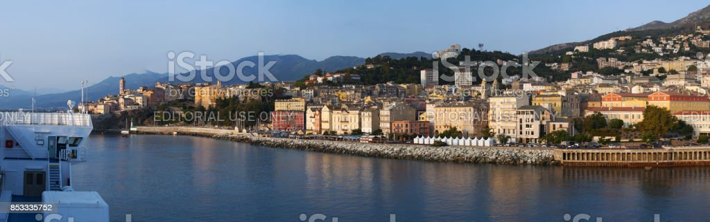Corsica: the skyline of Bastia, the city at the base of the Cap Corse, seen from the dock of the main port of the island from which ferries and cruises depart and arrive stock photo
