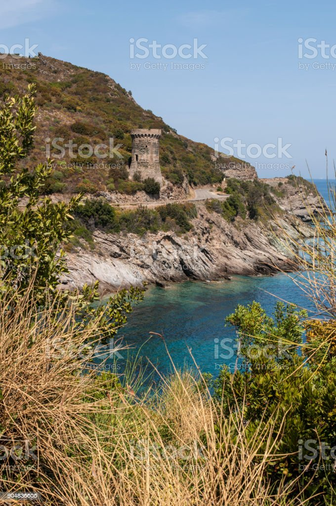 Corsica: the Tower of Losse, or Tower of l'Osse (1599), a ruined Genoese tower in the commune of Cagnano (Haute Corse) along the winding road of the eastern coast of the Cap Corse stock photo