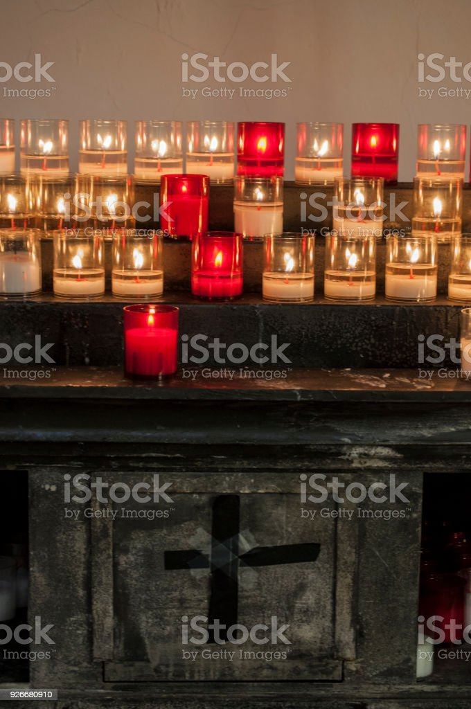 Corsica: votive candles inside the Basilica of Saint Mary Major, a Romanesque-style Roman Catholic church located in Bonifacio stock photo
