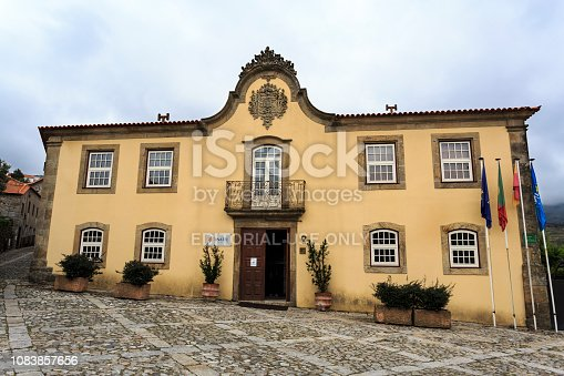 Facade of the magnificent 18th century Baroque Corte Reak Manor, topped by a cornice with an impressive coat of arms. Today is a luxury hotel in Linhares da Beira, Gouveia, Portugal
