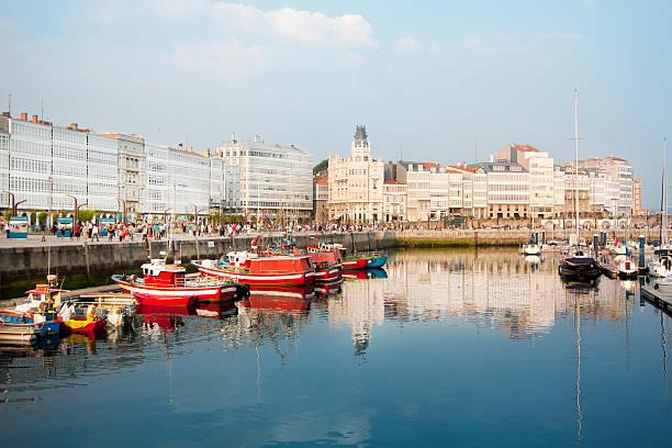 Coruña city, 'galerías' facades, skyline and old harbor. stock photo