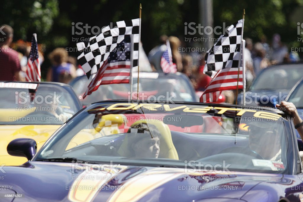 Corvette with Checkered Flags in July 4th Parade stock photo