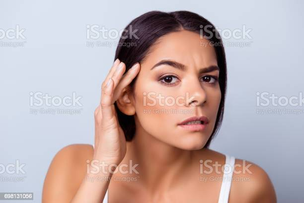 Cose up photo of pretty young latin american woman touching her face picture id698131056?b=1&k=6&m=698131056&s=612x612&h=5wy4qytguvp49zqbo5ywmxck9x39uvxzh0y24x2yl5q=