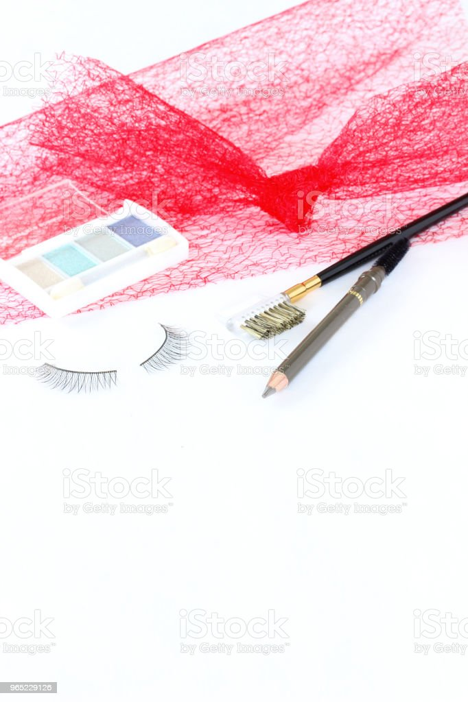 Cosmetic  and red tulle royalty-free stock photo
