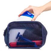 istock Cosmetic bag bath shampoo in hand razor toothbrush 1054662828