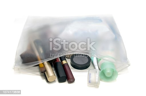 Cosmetic plastic bag essentials on white background