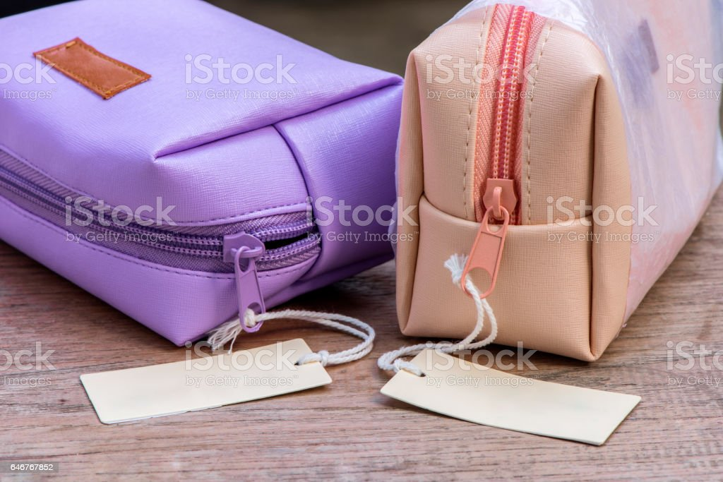 cosmetic bags with blank brown tag stock photo