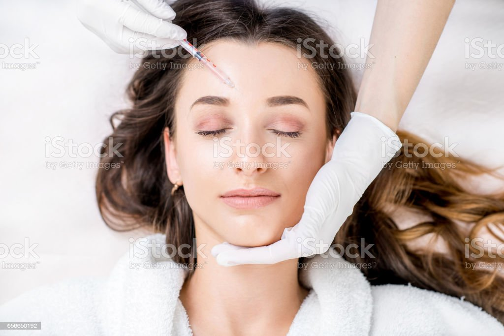 Cosmetic botox injection stock photo