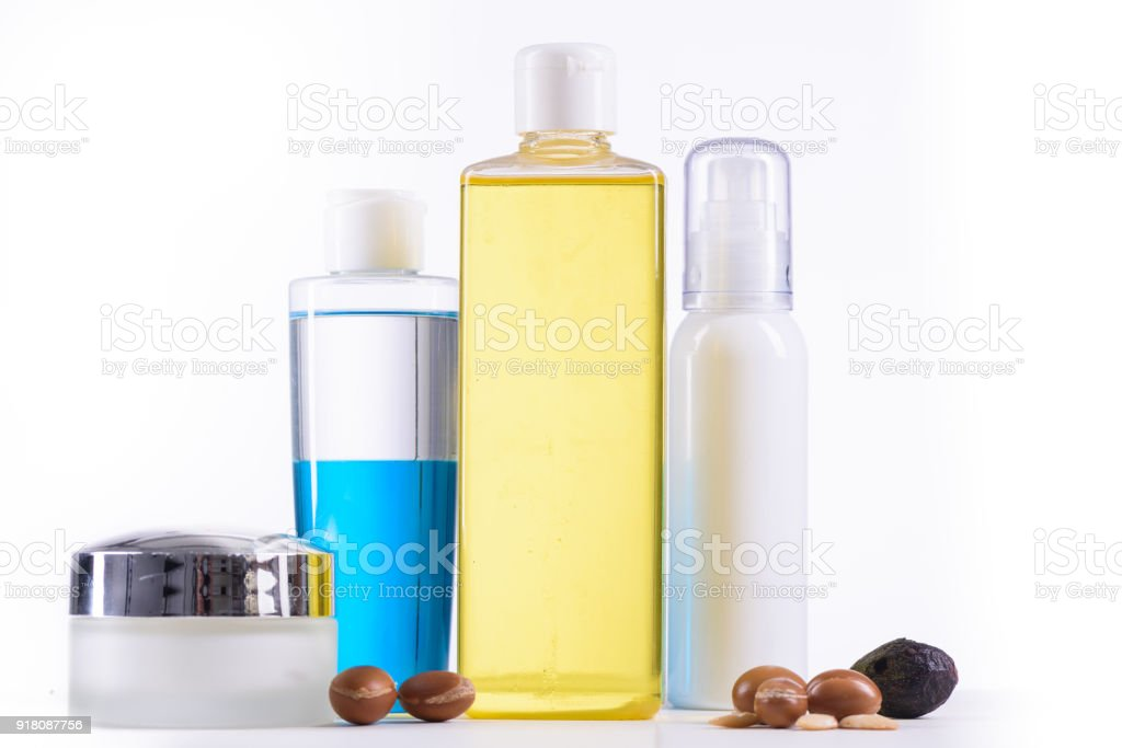 Cosmetic bottles and argan fruits stock photo
