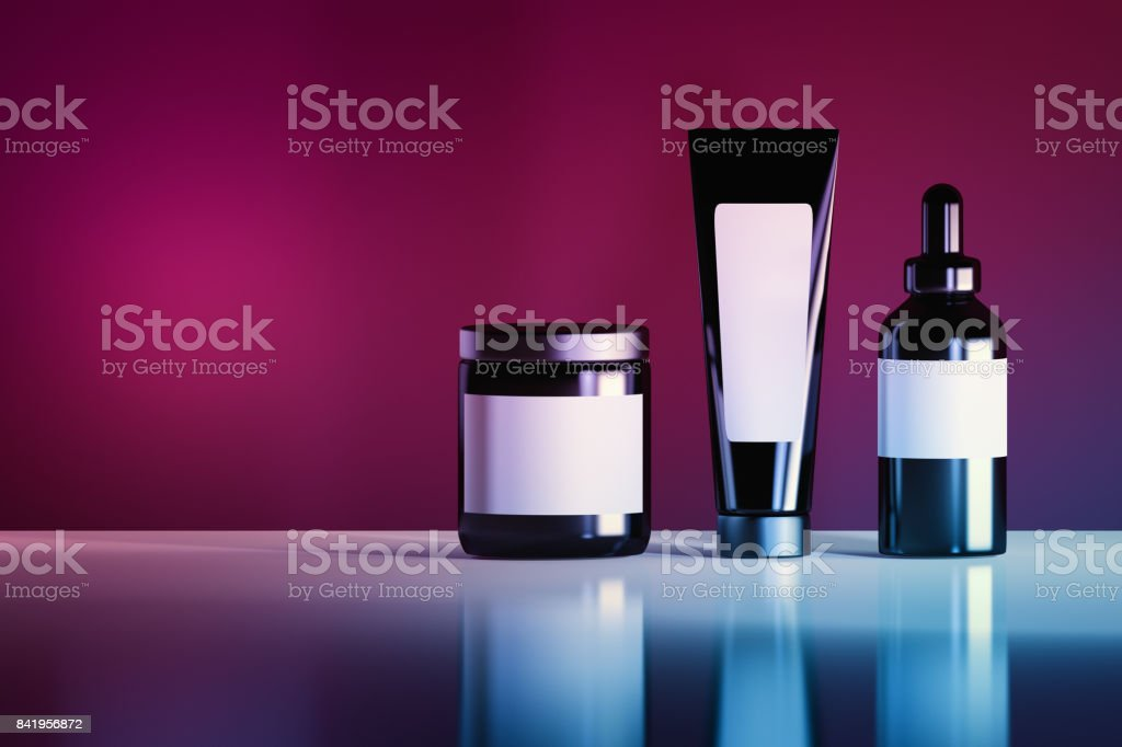 Cosmetic bottles in vibrant colors stock photo