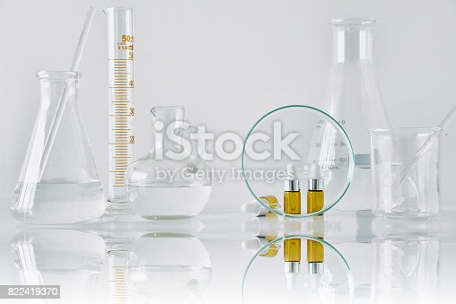 istock Cosmetic brown bottle containers and scientific glassware, Focus on blank package for branding mock-up 822419370