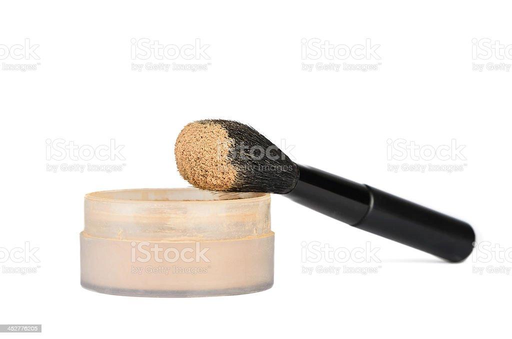 Cosmetic brush and powder stock photo