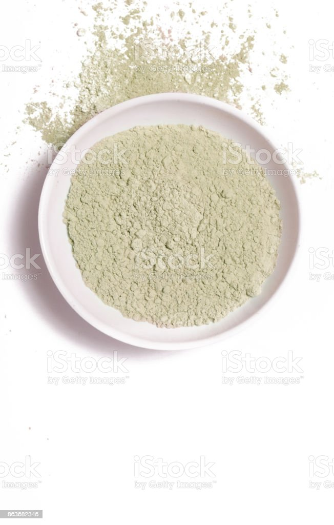 Cosmetic clay powder in the plastic container stock photo