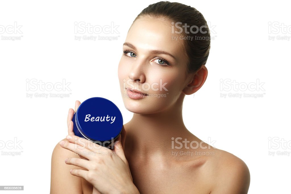 Cosmetic cream container in woman hands. Female hand with cream. royalty-free stock photo