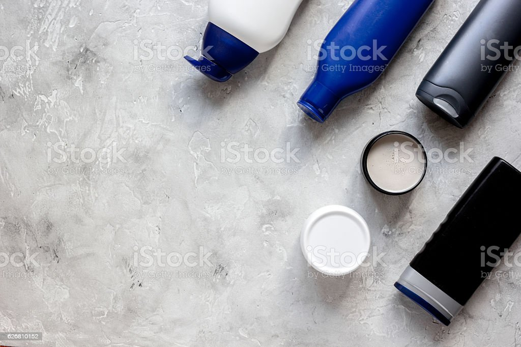 cosmetic for men in bottle on gray background top view stock photo