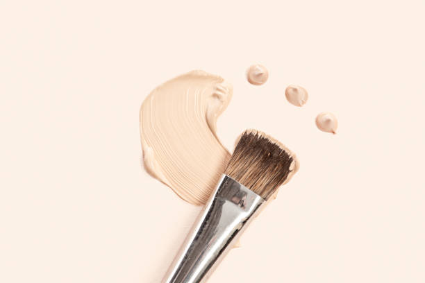 cosmetic foundation cream and powder with brush - make up stock pictures, royalty-free photos & images