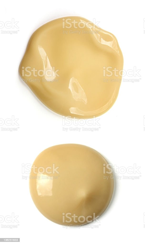 Cosmetic foundation liquid against white background royalty-free stock photo
