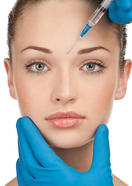 kosmetische injektion von botox - nadeldesigns stock-fotos und bilder