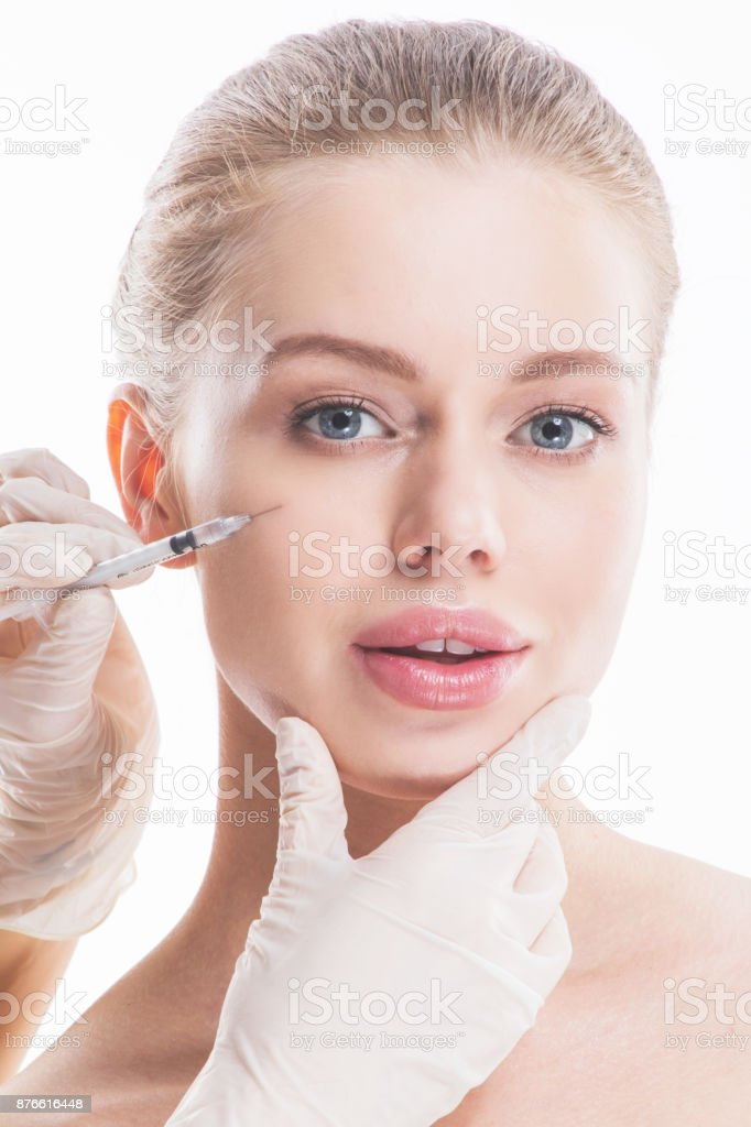 Cosmetic injection to female face stock photo