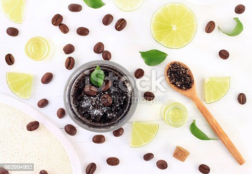 istock Cosmetic jar of homemade coffee based scrub, with fresh citrus essential oil 663994952