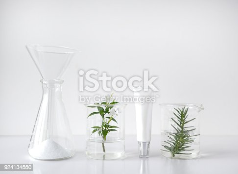 istock cosmetic laboratory research and development . science bio skincare cream serum product with leaves. natural organic beauty cosmetics concept. cosmetology. 924134550