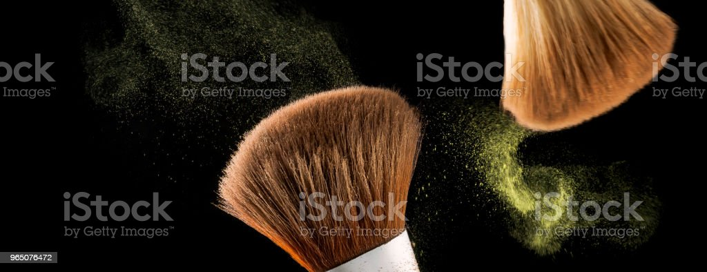 Cosmetic makeup brushes on  black background flash explosion spl royalty-free stock photo