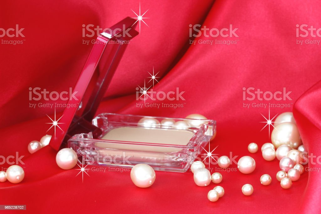 Cosmetic on the red cloth and peal royalty-free stock photo