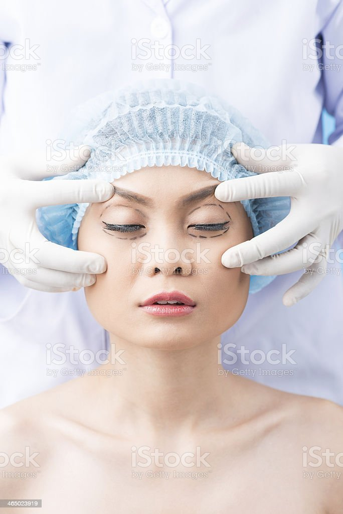 Cosmetic operation on eyes stock photo